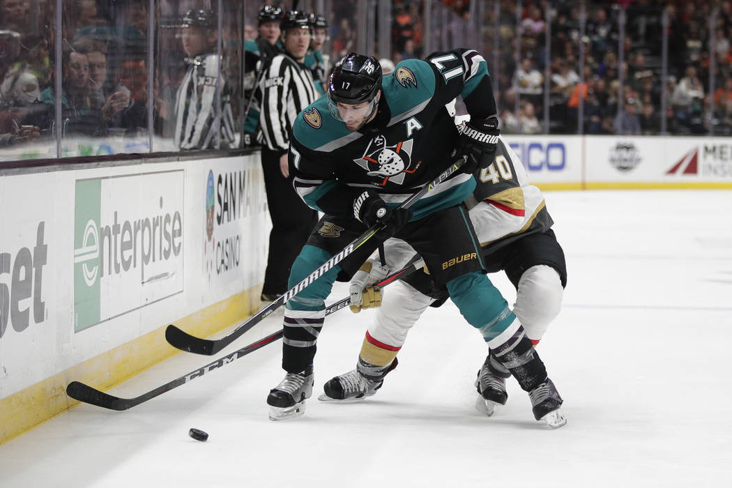 Anaheim Ducks' Ryan Kesler, front, moves the puck under pressure from Vegas Golden Knights' Ryan Carpenter during the second period of an NHL hockey game Friday, March 1, 2019, in Anaheim, Calif. ...