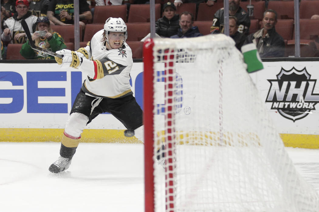 Vegas Golden Knights' Cody Eakin shoots to score an empty-net goal during the third period of the team's NHL hockey game against the Anaheim Ducks on Friday, March 1, 2019, in Anaheim, Calif. The ...