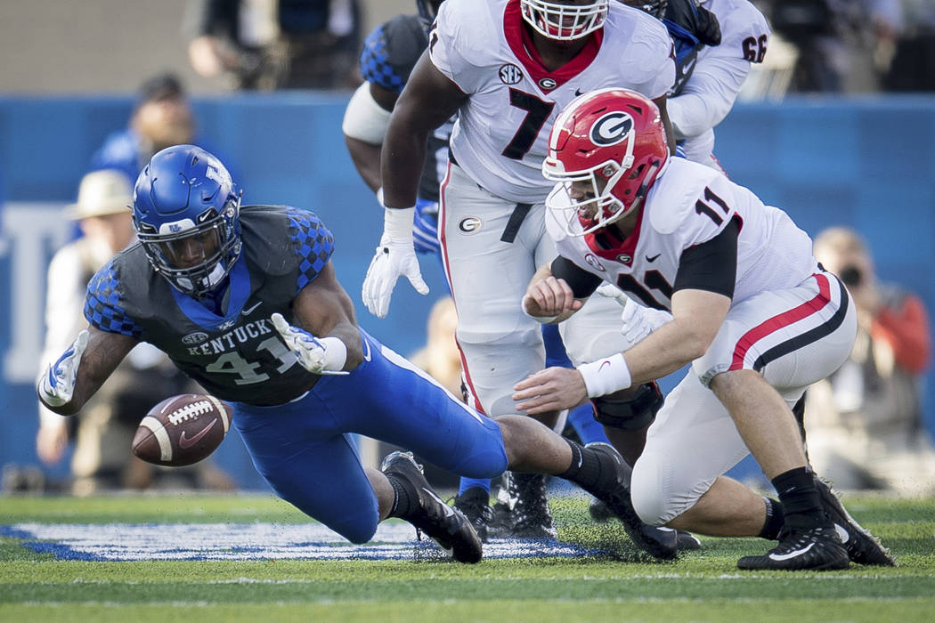 Kentucky linebacker Josh Allen (41) dives on the fumble of Georgia quarterback Jake Fromm (11) during the first half an NCAA college football game in Lexington, Ky., Saturday, Nov. 3, 2018. (AP Ph ...