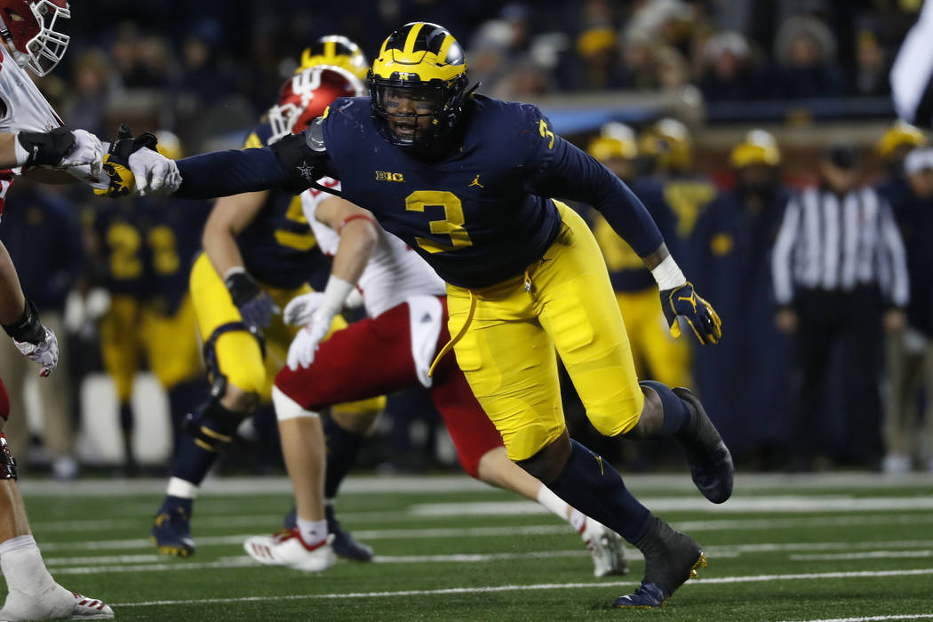 Michigan defensive lineman Rashan Gary (3) rushes against Indiana in the second half of an NCAA college football game in Ann Arbor, Mich., Saturday, Nov. 17, 2018. (AP Photo/Paul Sancya)