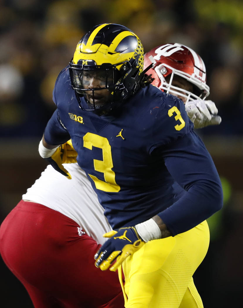 Michigan defensive lineman Rashan Gary rushes against Indiana in the second half of an NCAA college football game in Ann Arbor, Mich., Saturday, Nov. 17, 2018. (AP Photo/Paul Sancya)