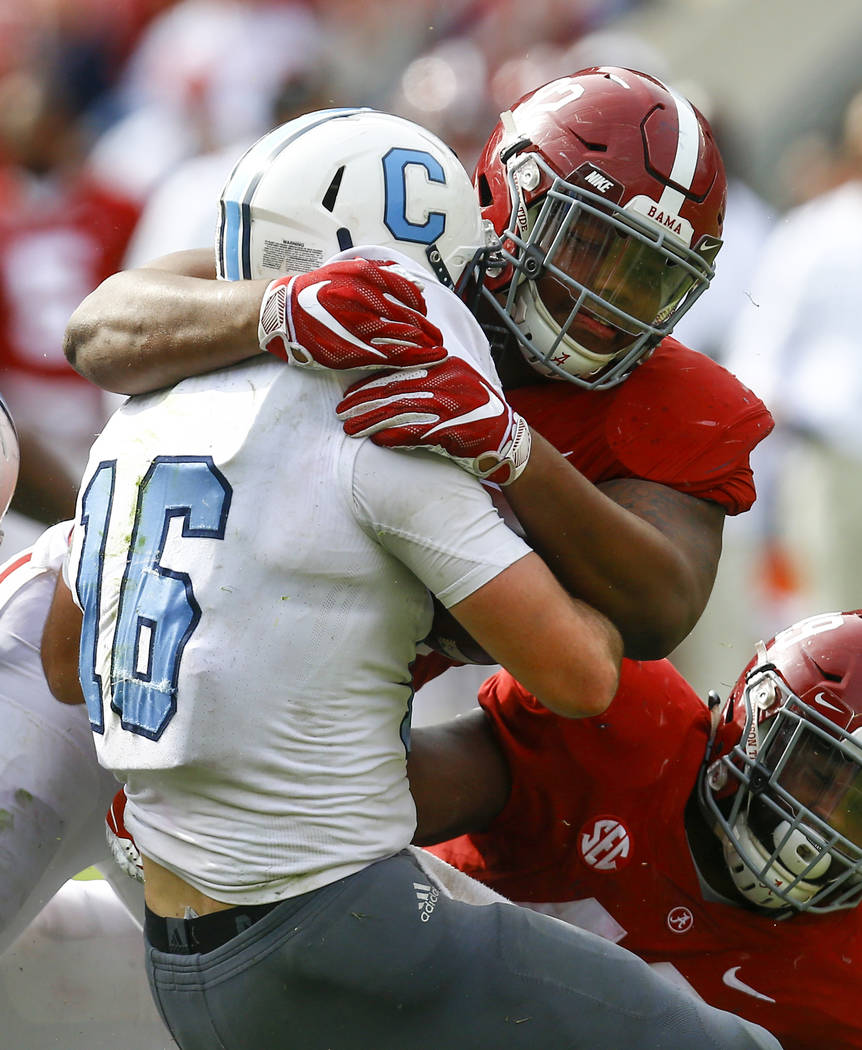 FILE - In this Nov. 17, 2018, file photo, Alabama defensive lineman Quinnen Williams (92) stops Citadel quarterback Brandon Rainey (16) during the second half of a game, in Tuscaloosa, Ala. Willia ...