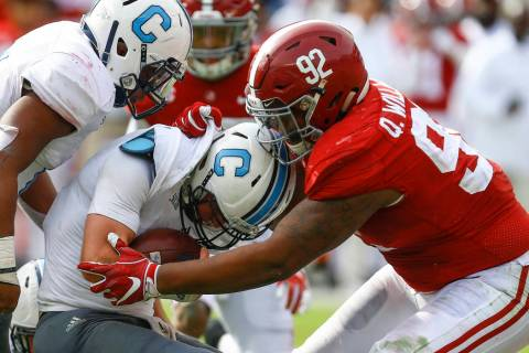 FILE - In this Nov. 17, 2018, file photo, Citadel quarterback Brandon Rainey (16) is stopped by Alabama defensive lineman Quinnen Williams (92) as he tries to carry the ball during the second half ...