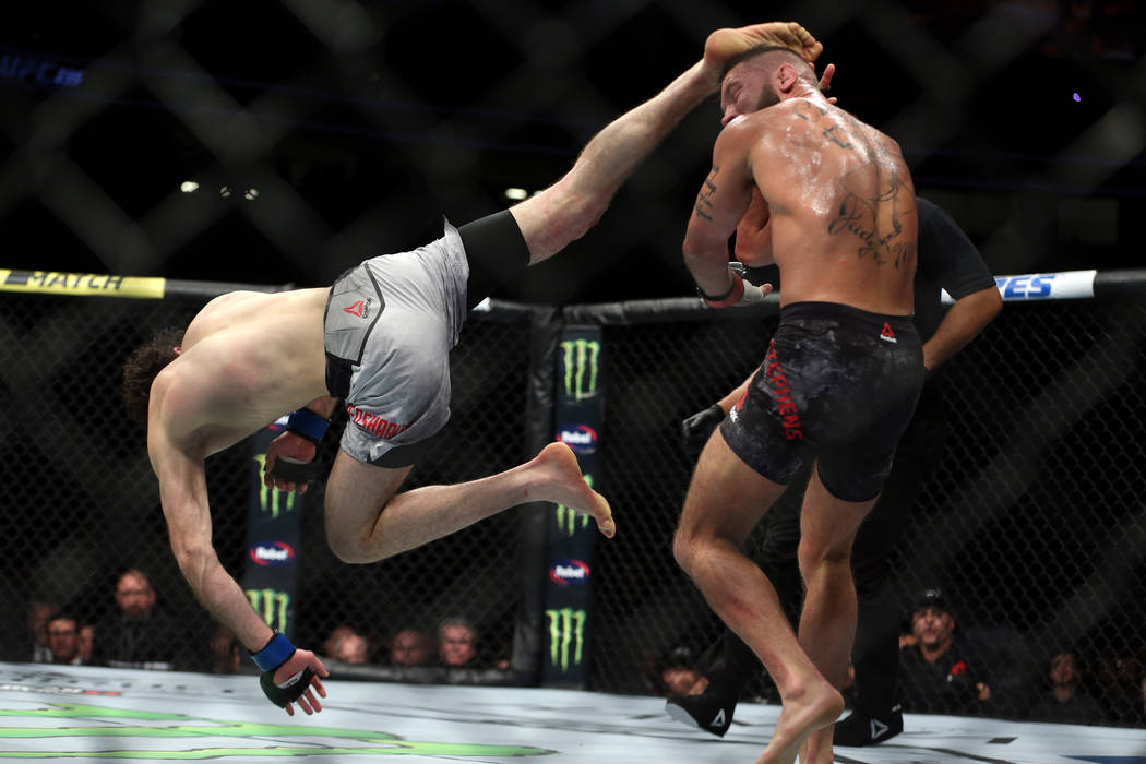 Zabit Magomedsharipov, left, leaps for a kick against Jeremy Stephens in the featherweight bout during UFC 235 at T-Mobile Arena in Las Vegas, Saturday, March 2, 2019. Magomedsharipov won by unani ...