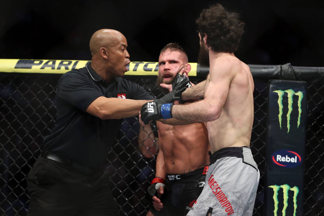 Zabit Magomedsharipov, right, throws a hand after the bell against Jeremy Stephens in the featherweight bout during UFC 235 at T-Mobile Arena in Las Vegas, Saturday, March 2, 2019. Magomedsharipov ...