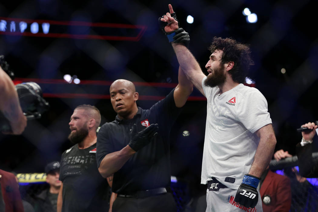 Zabit Magomedsharipov, right, raises his hand in victory by unanimous decision against Jeremy Stephens in the featherweight bout during UFC 235 at T-Mobile Arena in Las Vegas, Saturday, March 2, 2 ...