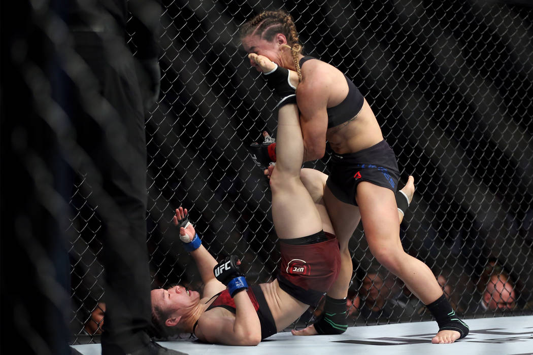 Weili Zhang, left, connects a kick against Tecia Torres in the womenÕs strawweight bout during UFC 235 at T-Mobile Arena in Las Vegas, Saturday, March 2, 2019. Zhang won by unanimous decision ...