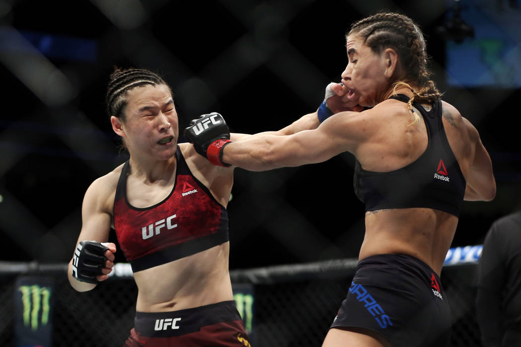 Weili Zhang, left, connects a punch against Tecia Torres in the womenÕs strawweight bout during UFC 235 at T-Mobile Arena in Las Vegas, Saturday, March 2, 2019. Zhang won by unanimous decisio ...