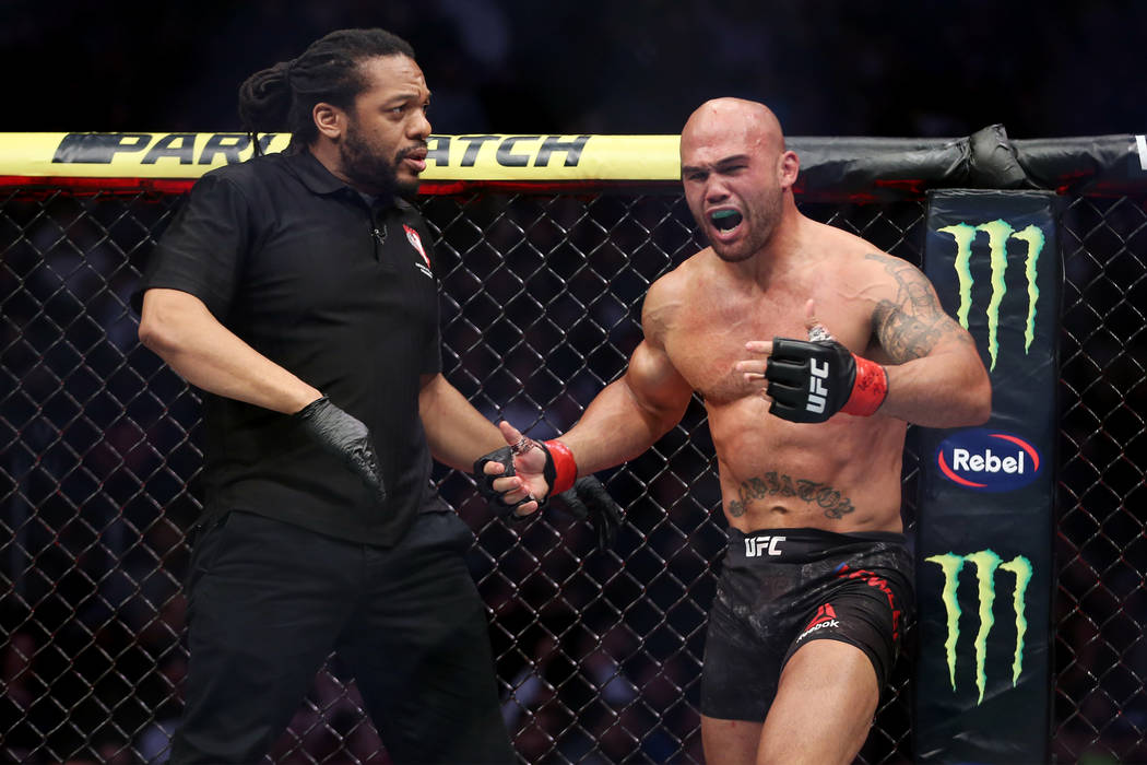 Robbie Lawler, right, protests his submission lost against Ben Askren in the first round of the welterweight bout during UFC 235 at T-Mobile Arena in Las Vegas, Saturday, March 2, 2019. (Erik Verd ...