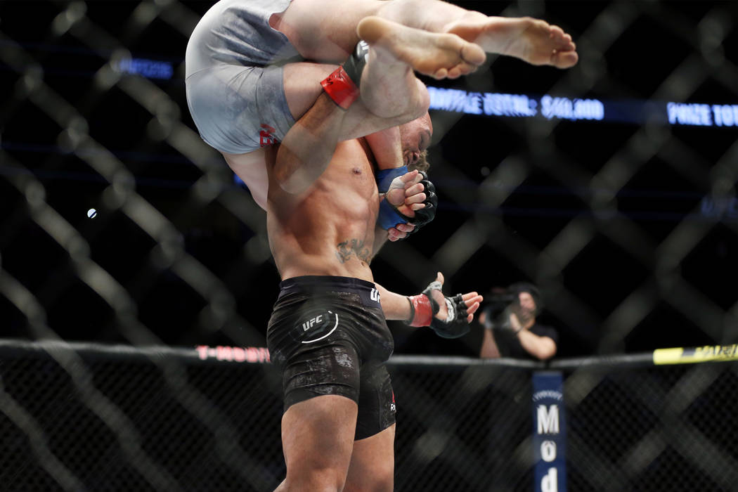 Robbie Lawler lifts Ben Askren before slamming him down on the octagon in the first round of the welterweight bout during UFC 235 at T-Mobile Arena in Las Vegas, Saturday, March 2, 2019. Askren wo ...
