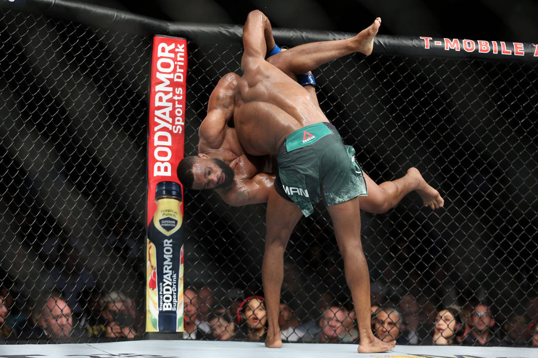 Kamaru Usman takes down Tyron Woodley in the welterweight title bout during UFC 235 at T-Mobile Arena in Las Vegas, Saturday, March 2, 2019. Usman won by unanimous decision. (Erik Verduzco/Las Veg ...