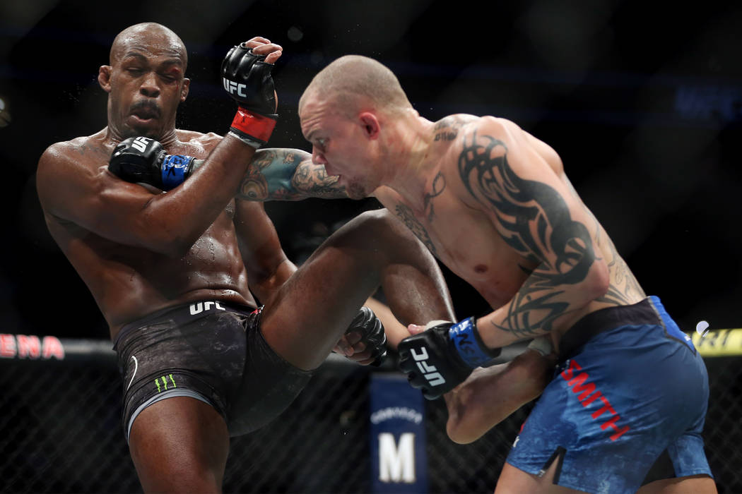 Jon Jones, left, battles Anthony Smith in the light heavyweight title bout during UFC 235 at T-Mobile Arena in Las Vegas, Saturday, March 2, 2019. Jones won by unanimous decision. (Erik Verduzco/L ...