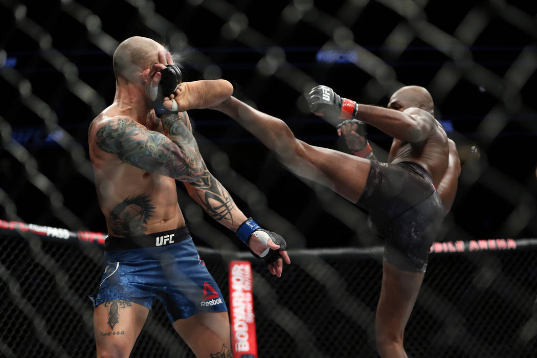 Jon Jones, right, kicks against Anthony Smith in the light heavyweight title bout during UFC 235 at T-Mobile Arena in Las Vegas, Saturday, March 2, 2019. Jones won by unanimous decision. (Erik Ver ...