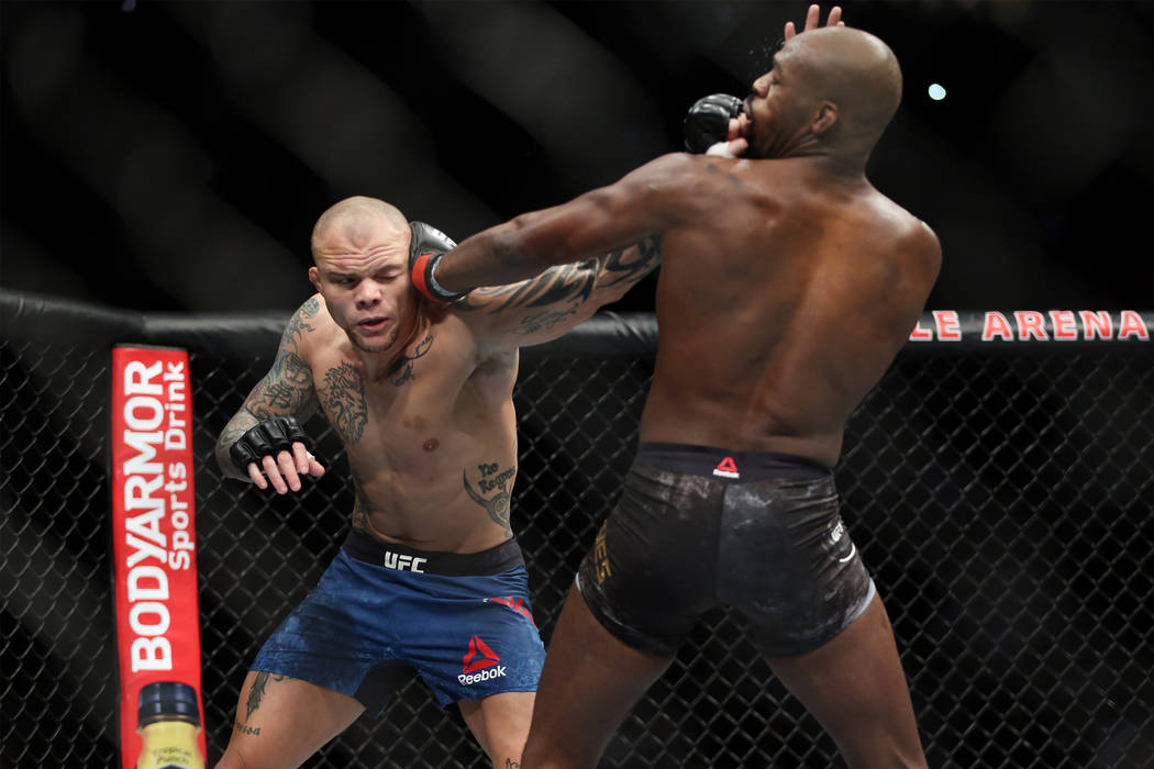 Anthony Smith, left, battles Jon Jones in the light heavyweight title bout during UFC 235 at T-Mobile Arena in Las Vegas, Saturday, March 2, 2019. Jones won by unanimous decision. (Erik Verduzco/L ...