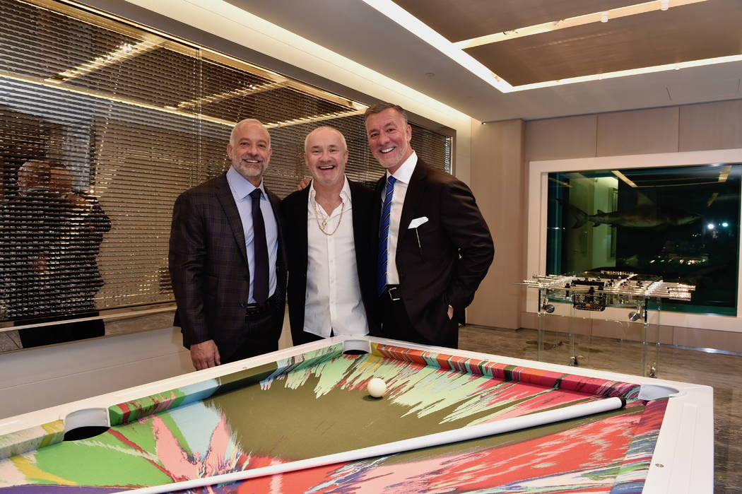 Lorenzo Fertitta, artist Damien Hirst and Frank Fertitta III are shown at Empathy Suite's opening party at the Palms on Friday, March 1, 2019. (Palms)