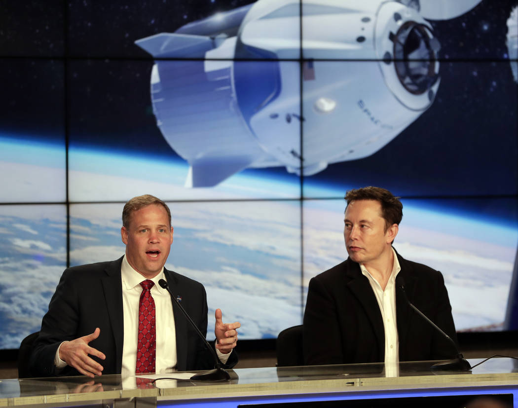 NASA Administrator Jim Bridenstine, left, and Elon Musk, CEO of SpaceX, answer questions during a news conference after the SpaceX Falcon 9 Demo-1 launch at the Kennedy Space Center in Cape Canave ...