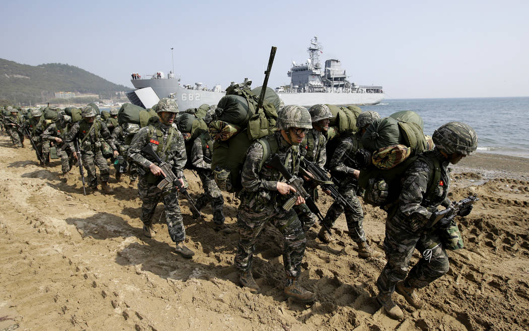 South Korean Marines march after landing on the beach during the U.S.-South Korea joint landing military exercises as a part of the annual joint military exercise Foal Eagle between South Korea an ...