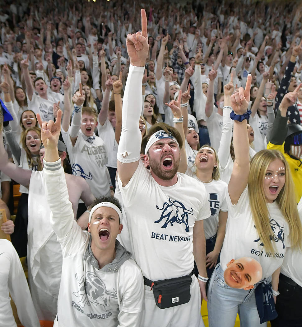 Utah State students cheer during the team's NCAA college basketball game against Nevada on Saturday, March 2, 2019, in Logan, Utah. (Eli Lucero/The Herald Journal via AP)