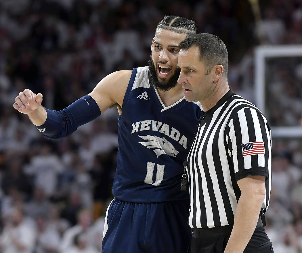 Nevada forward Cody Martin talks to a referee after getting called for a foul against Utah State during an NCAA college basketball game Saturday, March 2, 2019, in Logan, Utah. (Eli Lucero/The He ...