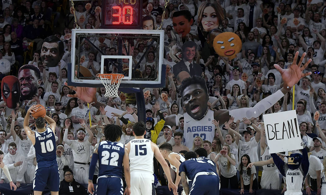 Utah State fans try to distract Nevada forward Caleb Martin (10) as he shoots a free throw during an NCAA college basketball game Saturday, March 2, 2019, in Logan, Utah. (Eli Lucero/The Herald Jo ...