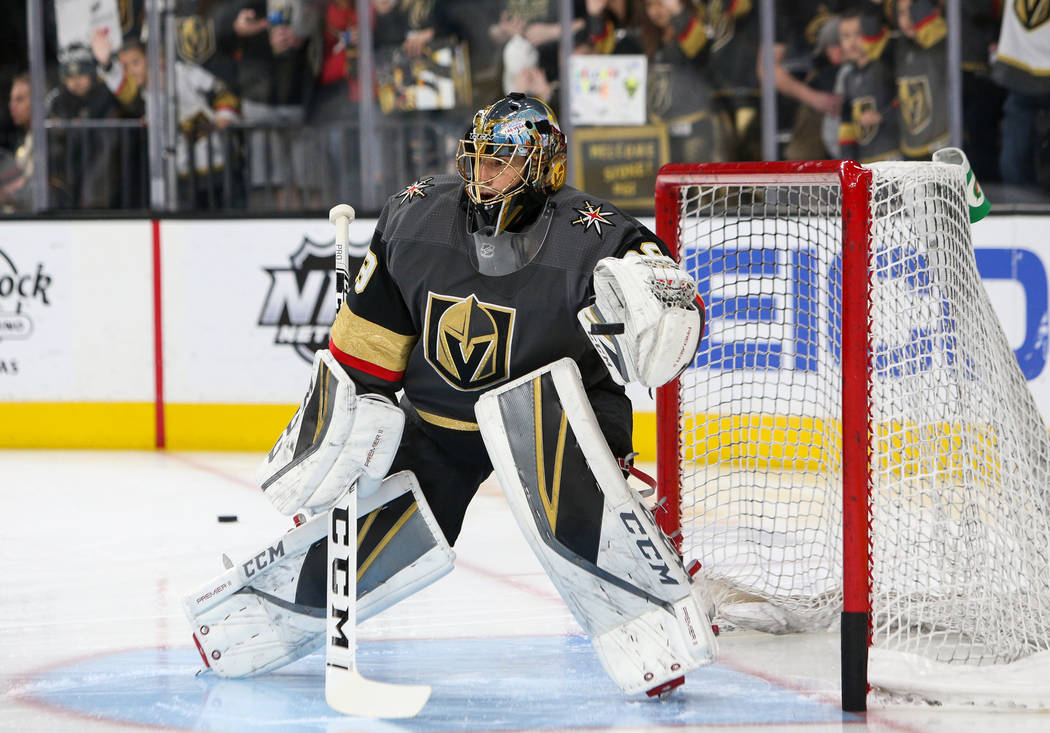Vegas Golden Knights goaltender Marc-Andre Fleury (29) stops a shot on goal during warmups of an NHL hockey game at T-Mobile Arenain Las Vegas, Sunday, March 3, 2019. (Caroline Brehman/Las Vegas R ...