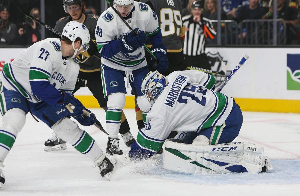 Vancouver Canucks goaltender Jacob Markstrom (25) blocks a shot from the Vegas Golden Knights during the first period of an NHL hockey game at T-Mobile Arenain Las Vegas, Sunday, March 3, 2019. (C ...