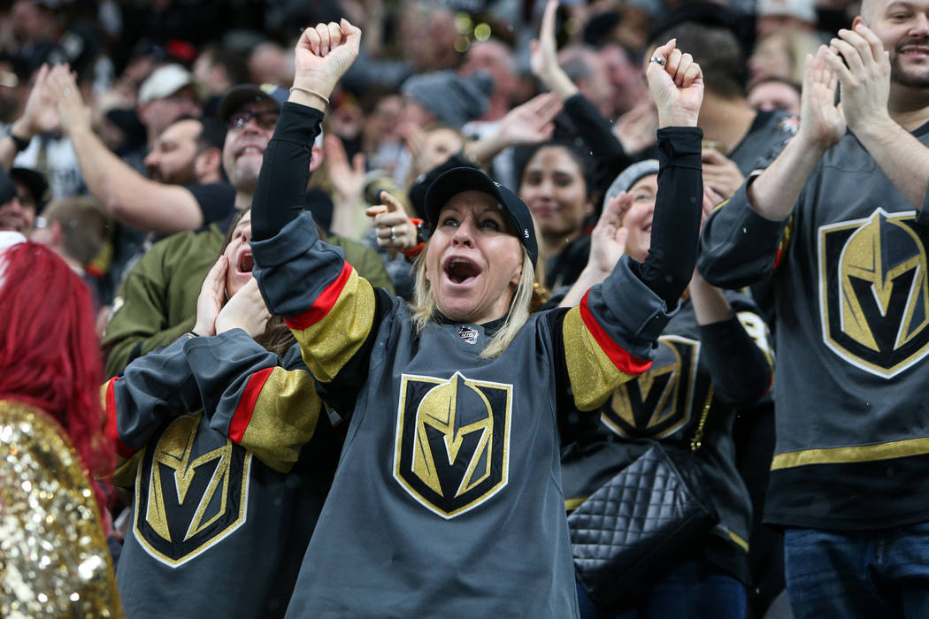 Fans cheer after Vegas Golden Knights center Ryan Carpenter (40) scores against the Vancouver Canucks during the second period of an NHL hockey game at T-Mobile Arena in Las Vegas, Sunday, March 3 ...