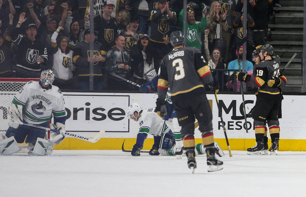 The Vegas Golden Knights celebrate after Vegas Golden Knights left wing Max Pacioretty (67) scores their third goal of the game against Vancouver Canucks goaltender Jacob Markstrom (25) during the ...