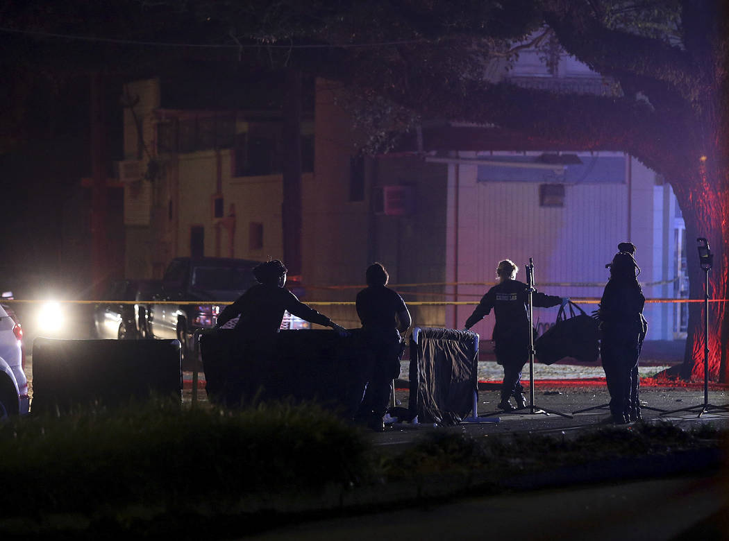 New Orleans police put up body screens around a victim on Esplanade Avenue at Mystery Street in New Orleans where a car struck multiple people, killing several and injuring others after the Endymi ...