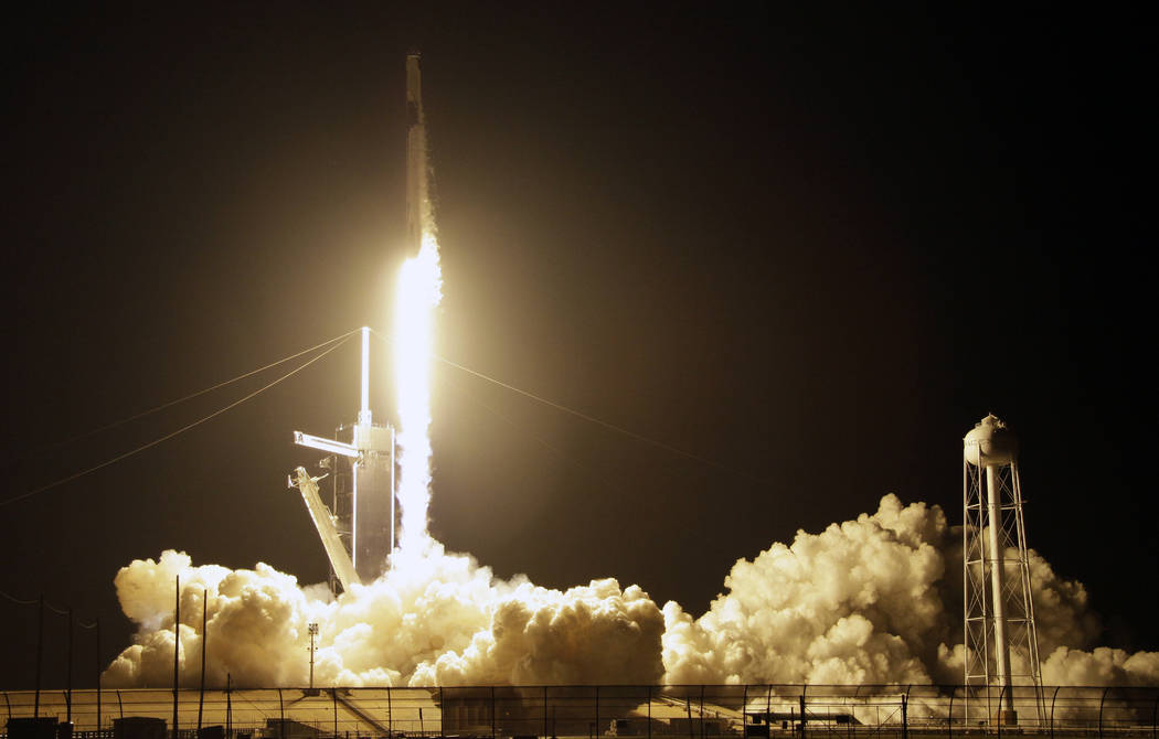 A SpaceX Falcon 9 rocket with a demo Crew Dragon spacecraft lifts off from pad 39A on an uncrewed test flight to the International Space Station at the Kennedy Space Center in Cape Canaveral, Fla. ...