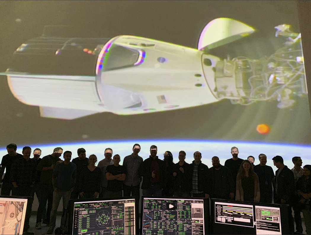 In this photo provided by SpaceX, the SpaceX team in Hawthorne, Calif., watches as the SpaceX Crew Dragon docks with the International Space Station's Harmony module, Sunday, March 3, 2019. ...
