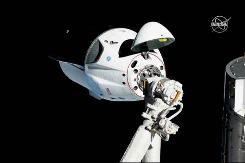 In this photo provided by NASA, the SpaceX Crew Dragon is pictured about 20 meters (66 feet) away from the International Space Station's Harmony module, Sunday, March 3, 2019. SpaceX's new ...