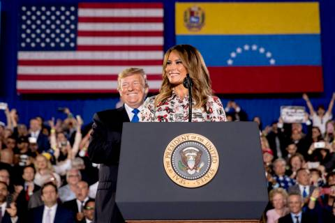 First lady Melania Trump, accompanied by President Donald Trump, smiles as she speaks in front of a Venezuelan American community at Florida Ocean Bank Convocation Center at Florida International ...