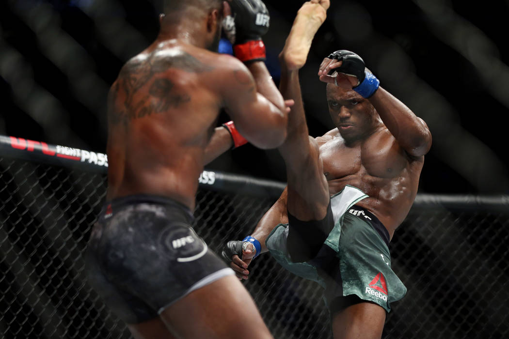 Kamaru Usman kicks Tyron Woodley in the welterweight title bout during UFC 235 at T-Mobile Arena in Las Vegas, Saturday, March 2, 2019. Usman won by unanimous decision. (Erik Verduzco/Las Vegas Re ...