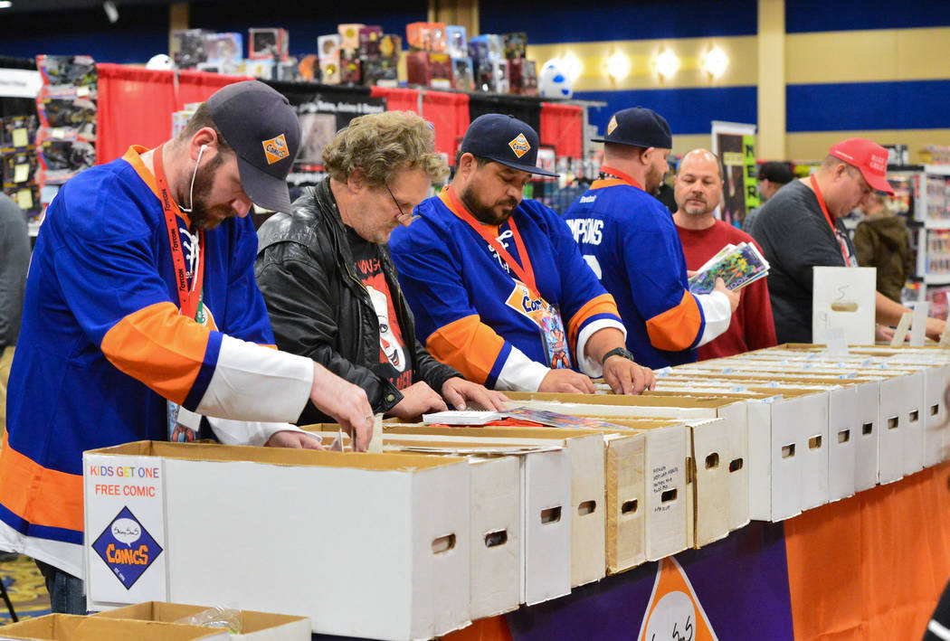 Conventiongoers and employees of ShimpSonS ComicS dig through boxes of comics at the Las Vegas Toy and Comic Convention at the Westgate Resort and Casino in Las Vegas, on Sunday, March 3, 2019. Br ...