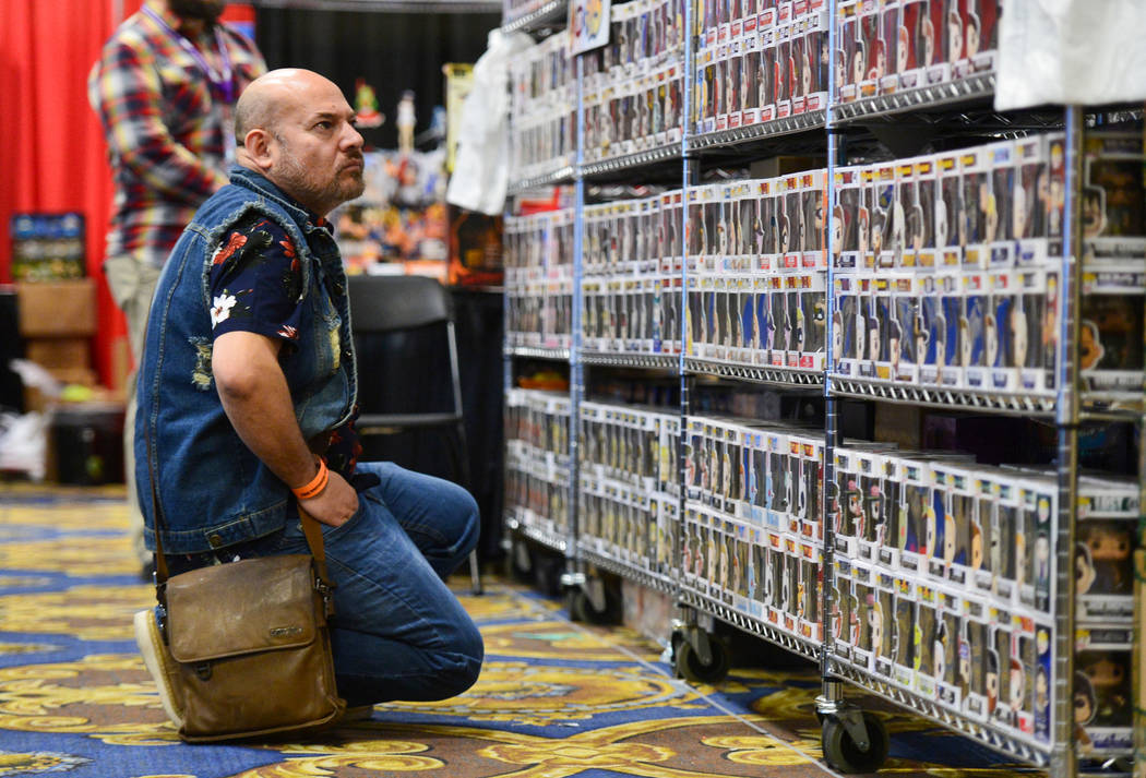 Joseph Aguilera scans rows upon rows of Pop! figurines at Las Vegas Toy and Comic Convention at the Westgate Resort and Casino in Las Vegas, on Sunday, March 3, 2019. Pop! makes figurines of chara ...