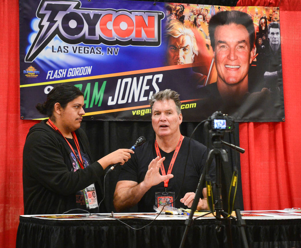 Sam Jones, who played Flash Gordon in the 1980 movie Flash Gordon, gives an interview Las Vegas Toy and Comic Convention at the Westgate Resort and Casino in Las Vegas, on Sunday, March 3, 2019. T ...