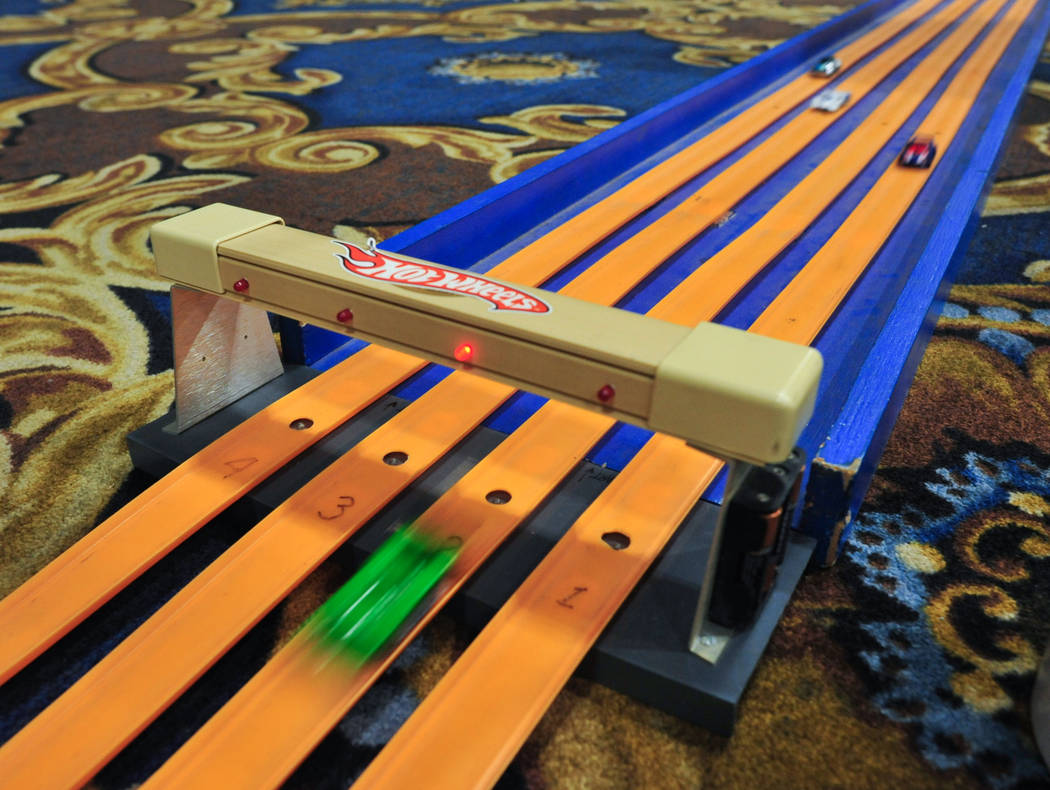 A diecast Panox LMP-1 die cast car crosses the line first in a downhill Hot Wheels Race at Las Vegas Toy and Comic Convention at the Westgate Resort and Casino in Las Vegas, on Sunday, March 3, 20 ...