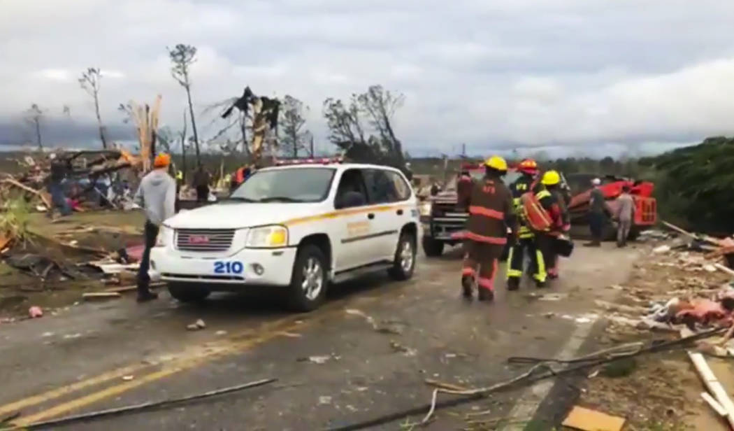 Emergency responders work in the scene amid debris in Lee County, Ala., after what appeared to be a tornado struck in the area Sunday, March 3, 2019. Severe storms destroyed mobile homes, snapped ...