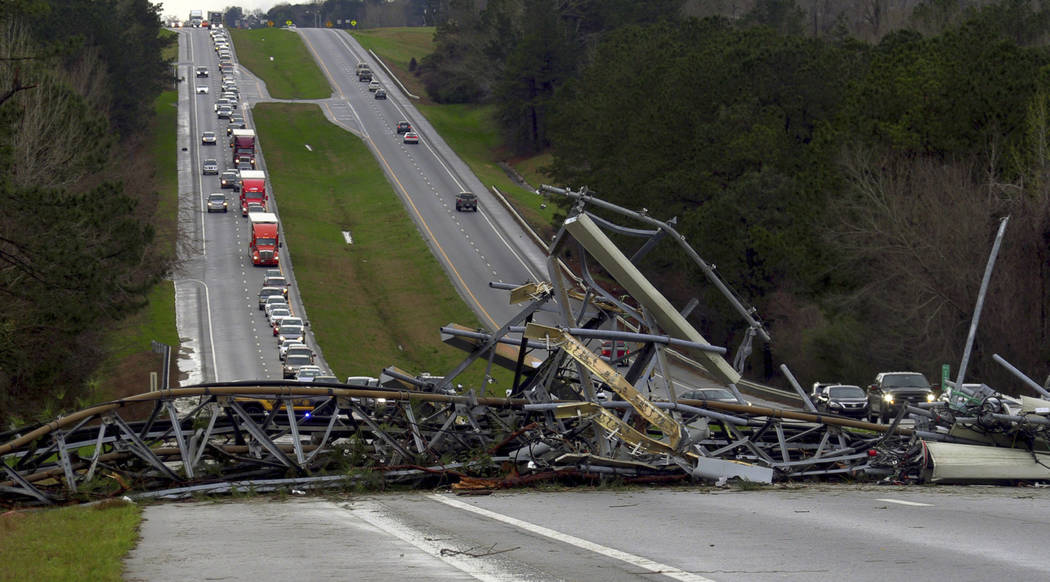 A fallen cell tower lies across U.S. Route 280 highway in Lee County, Ala., in the Smiths Station community after what appeared to be a tornado struck in the area Sunday, March 3, 2019. Severe sto ...
