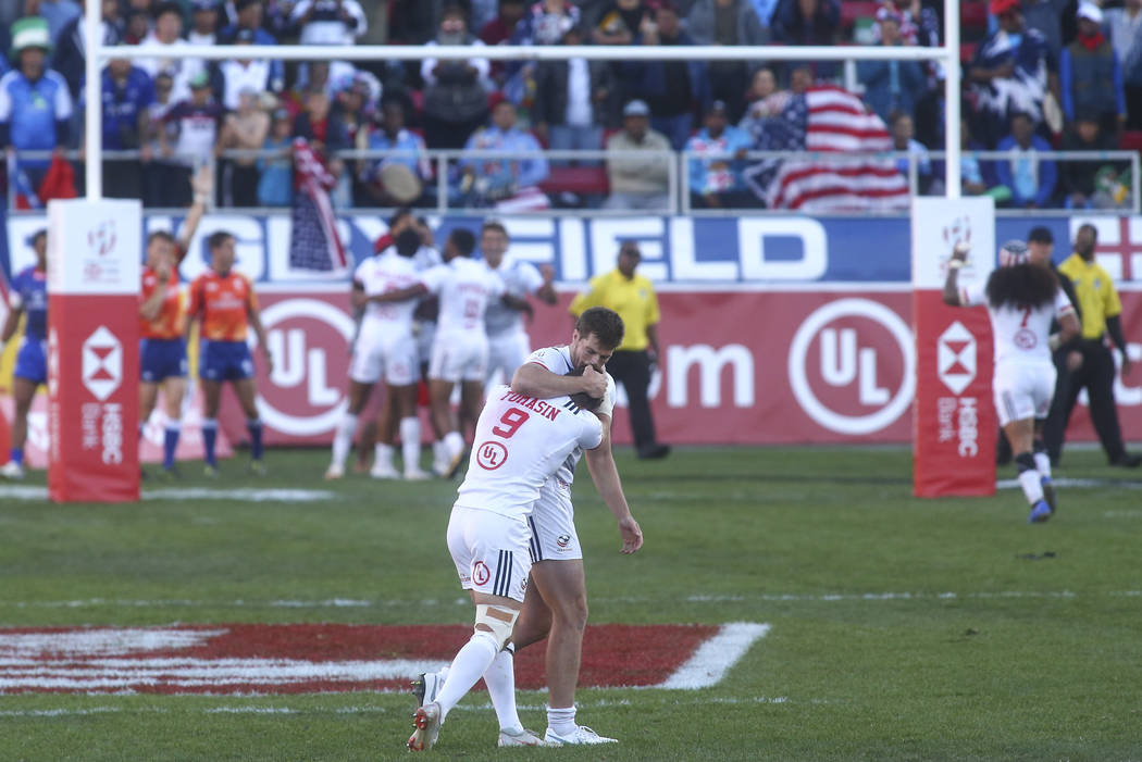 USA's Brett Thompson and Steve Tomasin (9) celebrate their victory over Samoa in the Cup Final during the USA Sevens Rugby Tournament at Sam Boyd Stadium in Las Vegas on Sunday, March 3, 2019. (Ch ...