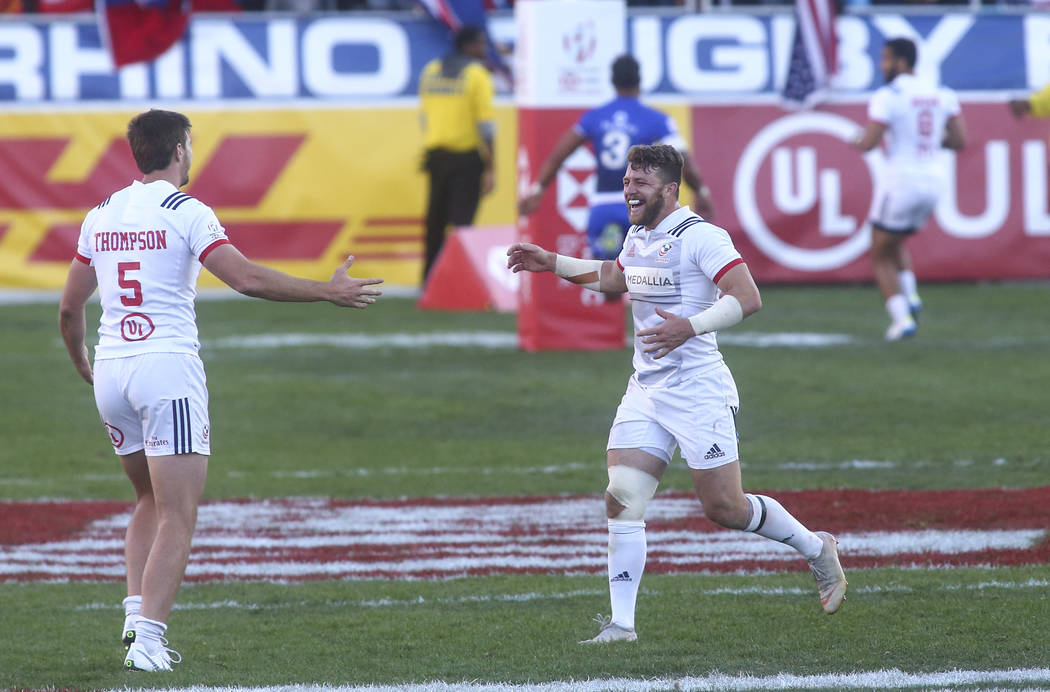 USA's Brett Thompson (5) and Steve Tomasin celebrate their victory over Samoa in the Cup Final during the USA Sevens Rugby Tournament at Sam Boyd Stadium in Las Vegas on Sunday, March 3, 2019. (Ch ...
