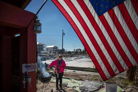 """Paulina """"Bela"""" Sebastiao lights a BBQ while waiting for her damaged house from Hurricane Michael to be torn down in Mexico Beach, Fla, Friday, Jan. 25, 2019. Since the storm destroyed th ..."""