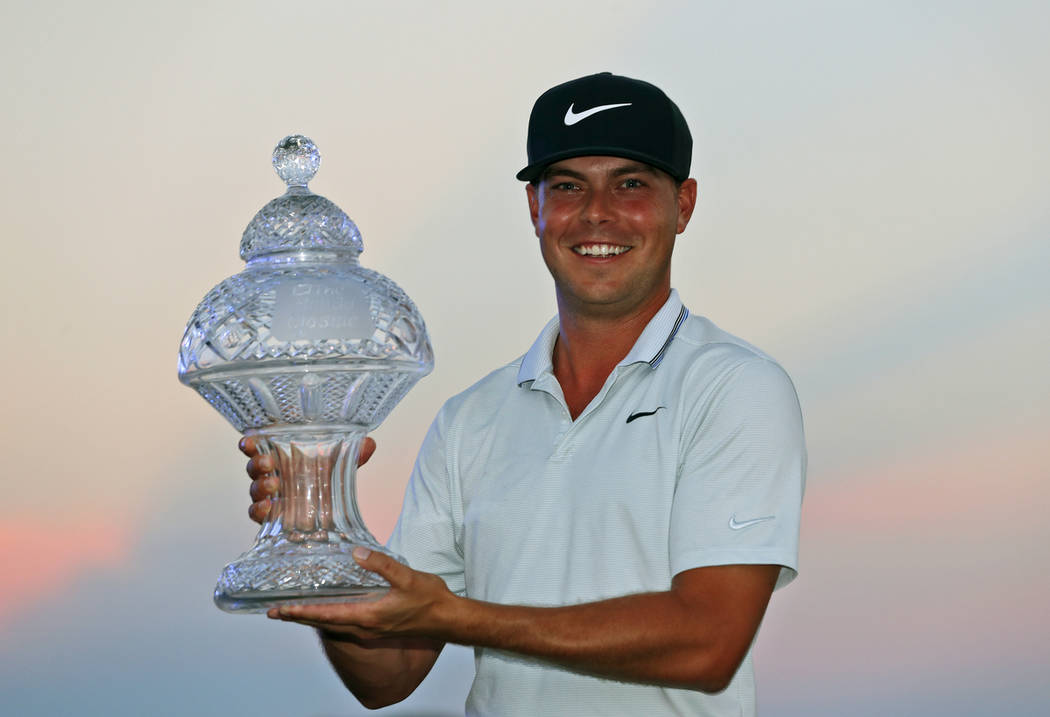 Keith Mitchell holds up his trophy after winning the Honda Classic golf tournament Sunday, March 3, 2019, in Palm Beach Gardens, Fla. (AP Photo/Wilfredo Lee)