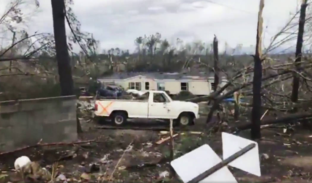 This photo shows debris in Lee County, Ala., after what appeared to be a tornado struck in the area Sunday, March 3, 2019. Severe storms destroyed mobile homes, snapped trees and left a trail of d ...