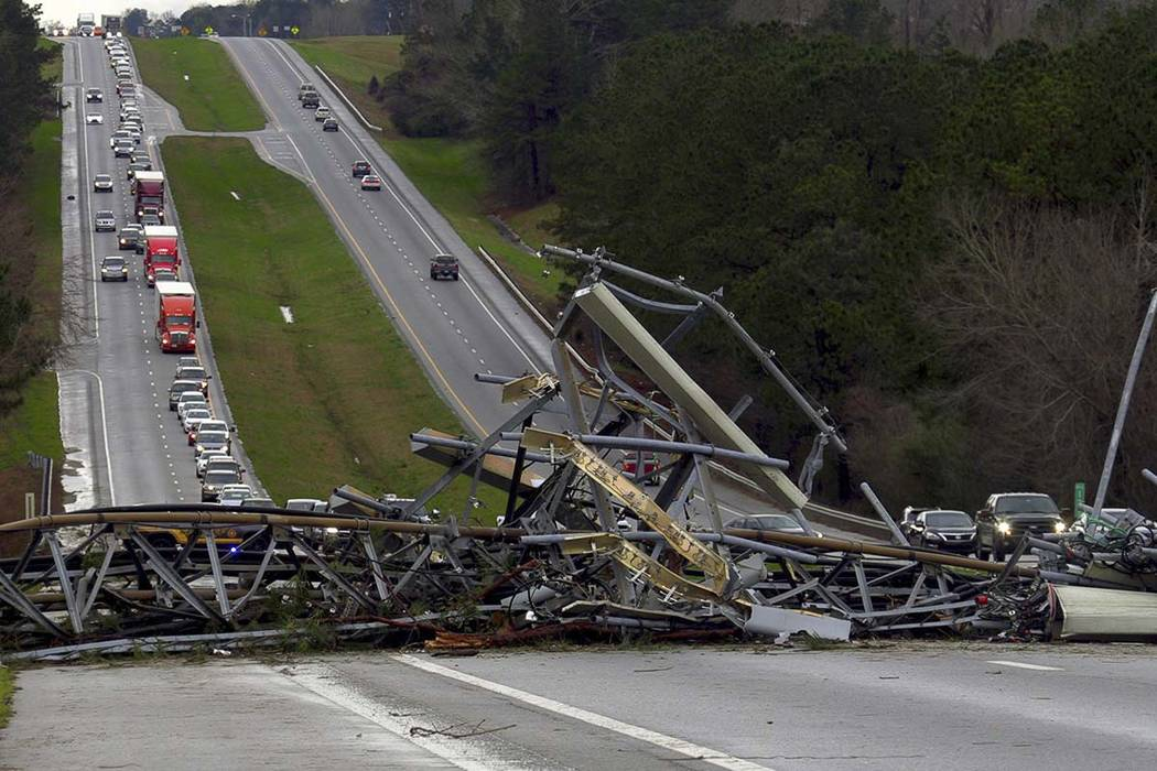 A fallen cell tower lies across U.S. Route 280 highway in Lee County, Ala., in the Smiths Station community after a tornado struck in the area Sunday, March 3, 2019. Severe storms destroyed mobile ...