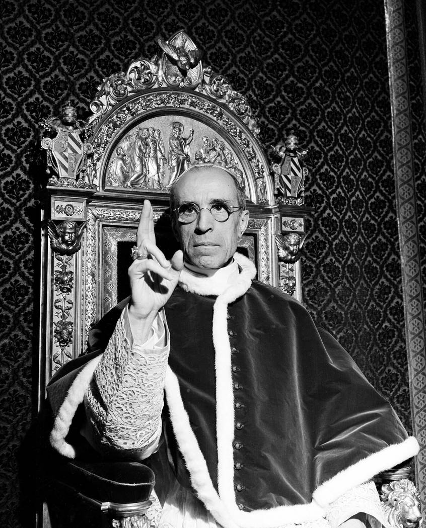 Pope Pius XII, wearing the ring of St. Peter, raises his right hand in a papal blessing at the Vatican in September 1945. Pope Francis said Monday, March 4, 2019 he has decided to open up to resea ...
