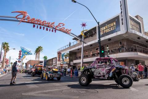 The Mint 400 Vehicle Procession rounds the turn from Las Vegas Boulevard onto East Fremont Street on March 9, 2016. Vehicles are arriving for the official kickoff of the annual Mint 400 off-road r ...