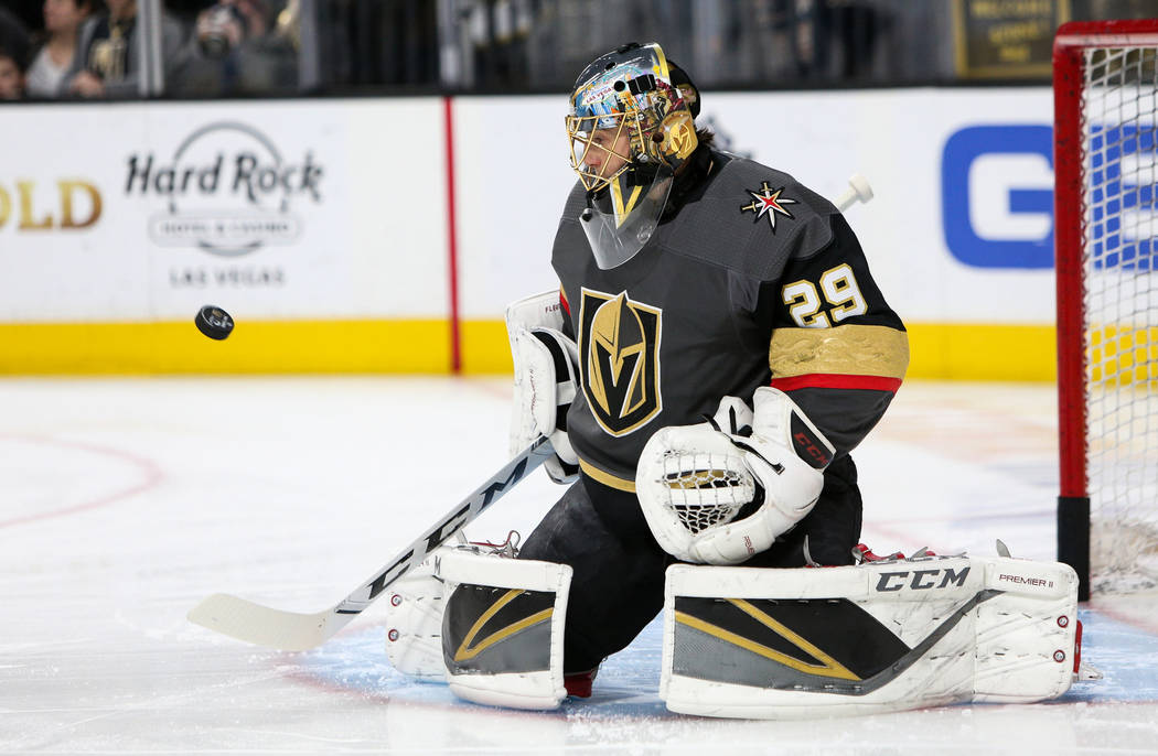 Vegas Golden Knights goaltender Marc-Andre Fleury (29) saves a shot on goal during warmups of an NHL hockey game at T-Mobile Arenain Las Vegas, Sunday, March 3, 2019. (Caroline Brehman/Las Vegas R ...