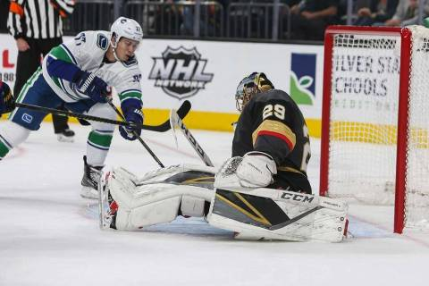 Vegas Golden Knights goaltender Marc-Andre Fleury (29) blocks a shot from Vancouver Canucks right wing Nikolay Goldobin (77) during the second period of an NHL hockey game at T-Mobile Arena in Las ...